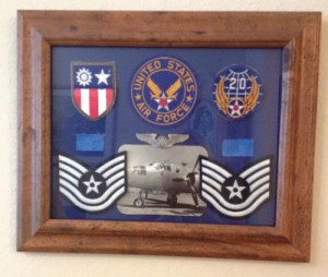 The collage of patches and photos is George's Tech Sergeant stripes, 20th Air Force Patch and other mementos.